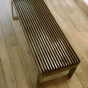 Slatted table in naturally rusted steel