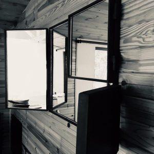 Multi-sided folding wall mirror in steel